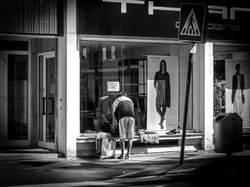 Homeless woman changing her clothes