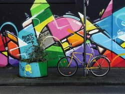 Yellow bike Streetart by ONETRUTH.CH